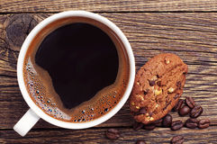Closeup coffee and chocolate cookies Royalty Free Stock Image