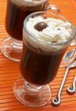 Closeup of coffee with cream. (Caffe Borgia) with spoons next to it Stock Photography