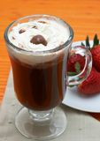 Closeup of coffee with cream. (Caffe Borgia) with some strawberries on the side Royalty Free Stock Photo