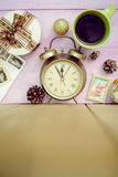 Closeup of coffee cup, alarm clock and christmas Royalty Free Stock Image