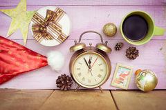 Closeup of coffee cup, alarm clock and christmas Royalty Free Stock Photo