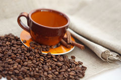 Coffee cup with dry roasted beans Stock Photo