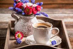 Closeup of coffee and spring flowers Stock Photography
