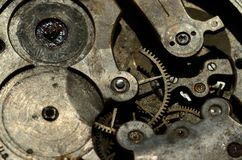 Closeup of cogweels in clockwork, grunge  steampunk background Stock Photos