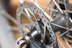 Closeup cogwheel attached to bicycle wheel, mechanical repair concept Royalty Free Stock Image