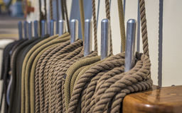 Closeup of coiled rope on a ship deck Stock Photo