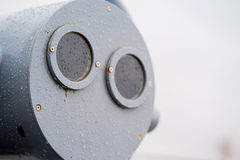 closeup coin operated binoculars overlooking after rain Royalty Free Stock Photography
