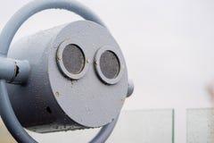 closeup coin operated binoculars overlooking after rain Royalty Free Stock Photos