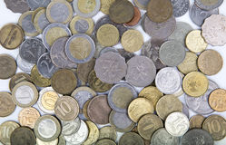 Closeup of coins from different countries. On a white surface Royalty Free Stock Image