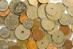 Closeup of coins from multiple countries. Flat lay top view Royalty Free Stock Image