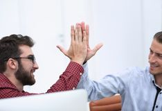 Closeup.colleagues giving each other high five. Photo with copy space royalty free stock photo