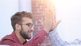 Closeup.colleagues giving each other high five. Photo with copy space stock image