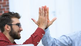 Closeup.colleagues giving each other high five. Photo with copy space stock photos