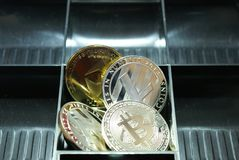 a collection of cryptocurrency in a lockbox stock images