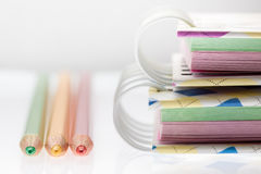 Closeup color pencil and notebook,Selective focus. Royalty Free Stock Photo