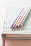 Closeup color pencils on green notebook Stock Image