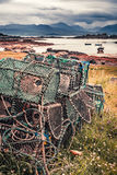 Closeup of colored cage for lobster on shore, Scotland Royalty Free Stock Image