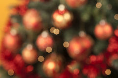 Closeup of colored Christmas balls out of focus on colored backg Royalty Free Stock Photos