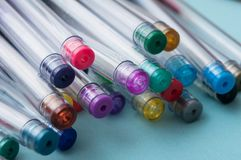 Colorful ballpoint pens on color background. Closeup of colorful ballpoint pens on color background royalty free stock photo