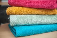 Colorful bath towels pile in store. Closeup of colorful bath towels pile in store Stock Images