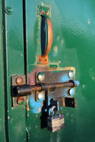 Closeup of a Colorful Bolt Lock on a Shed Stock Photo