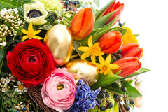 Closeup of colorful bouquet with golden eggs Stock Images