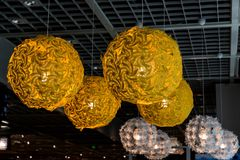 Closeup of colorful ceiling lamps. Hanging in a fastfood restaurant royalty free stock photography