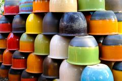 Closeup colorful ceramic vase arranged. In layers royalty free stock images