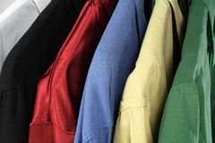 Closeup of colorful clothes. (shirts of different colors stock image