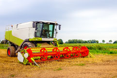 Closeup of a colorful combine parked after finishing the work Royalty Free Stock Photos