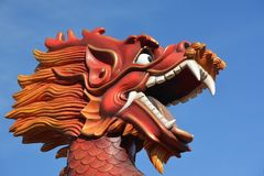 Closeup on a colorful dragon head stock photography