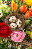 Closeup of colorful easter bouquet with eggs Stock Images