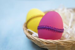 Closeup colorful Easter egg in wooden basket Royalty Free Stock Photography