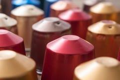 Colorful espresso coffee doses. Closeup of colorful espresso coffee doses royalty free stock images