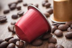 Colorful espresso coffee doses with coffee beans on. Closeup of colorful espresso coffee doses with coffee beans on wooden table background royalty free stock image