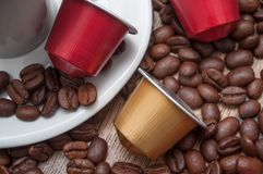 Colorful espresso coffee doses with coffee beans on. Closeup of colorful espresso coffee doses with coffee beans on wooden table background stock photos