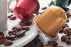 Colorful espresso coffee doses with coffee beans on. Closeup of colorful espresso coffee doses with coffee beans on white table background royalty free stock images