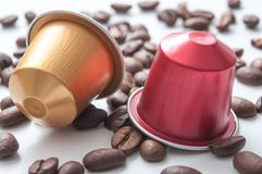 Colorful espresso coffee doses with coffee beans on w. Closeup of colorful espresso coffee doses with coffee beans on white table background stock image