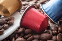 Colorful espresso coffee doses with coffee beans on w. Closeup of colorful espresso coffee doses with coffee beans on wooden table background royalty free stock image