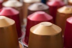 Colorful espresso coffee doses. Closeup of colorful espresso coffee doses royalty free stock photography