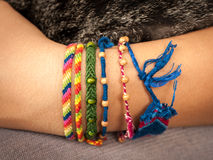 Colorful friendship bracelet on a child`s hand Royalty Free Stock Image