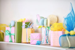 Closeup of colorful gifts box on shelf. Holyday decor. Closeup of colorful gifts box on shelf. Christmas or holyday decor Royalty Free Stock Photo