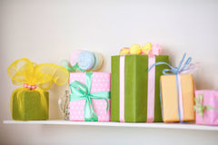 Closeup of colorful gifts box on shelf. Holyday decor. Closeup of colorful gifts box on shelf. Christmas or holyday decor Stock Photo