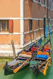 Closeup of colorful gondola on a canal in Venice Italy. Beautiful view of traditional gondola on famous Venice canal, Italy Royalty Free Stock Photo