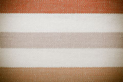 Closeup of colorful gray orange white striped textile as background or texture Royalty Free Stock Photos