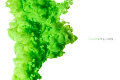 Closeup of a colorful green acrylic ink in water isolated on white with copy space. Abstract background. Color explosion. Paint royalty free stock photos