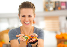 Closeup on colorful halloween gummy worm candies in woman hands Royalty Free Stock Photos