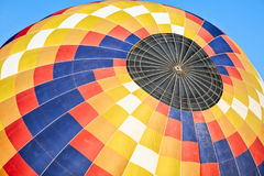 Closeup of a colorful hot-air balloon Stock Images