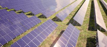 Closeup of colorful panoramic aerial view landscape:solar power plant High-resolution 3D CG rendering illustration stock photography