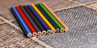 Closeup colorful pencils. Back to school concept. Background education office drawing art group rainbow design paint sharp palette crayon red wooden colored row stock photography